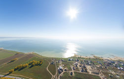 Aerial view of a summer house village at blue sea coast. Stock Photo