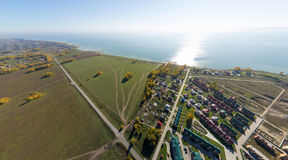 Aerial view of a summer house village at blue sea coast. Stock Image