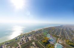 Aerial view of a summer house village at blue sea coast. Royalty Free Stock Photo