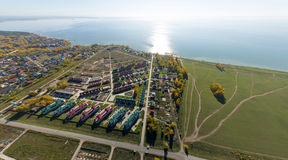 Aerial view of a summer house village at blue sea Royalty Free Stock Photos