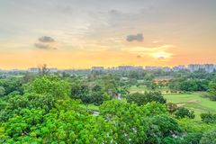 Aerial view sun setting behind park lakeside apartments in Singapore stock image