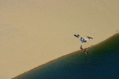 Aerial view on sunbather. A group of people sunbathing and swimming on a beach (Fraser Island, Australia Stock Photos