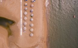 Aerial view of sunbeds on the beach.Corfu Greece Europe. Corfu Greece Europe royalty free stock images
