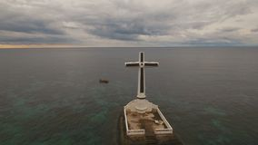 Catholic cross in the sea. stock video footage