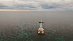 Catholic cross in the sea. stock video