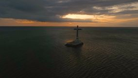 Catholic cross in the sea. stock footage