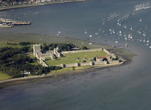 Aerial view of sunlit Porchester Castle. Ruins of Roman Portchester Castle bathed in sunlight Stock Photos
