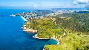 Aerial view on sunny beach with residential suburb on the background. Coromandel Peninsula, New Zealand. Stock Photo