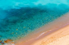 Aerial view of sunny beach and transparent clean sea water.  royalty free stock photography