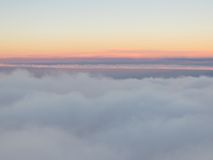 Aerial view of sunrise above the clouds. Stock Images