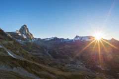 Aerial view at sunrise of Breuil Cervinia village and Cervino or Matterhorn mountain peak, famous ski resort in Aosta Valley, Ita royalty free stock image