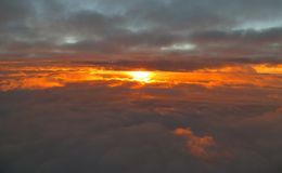 Aerial view of sunrise between cloud layers. Royalty Free Stock Photos