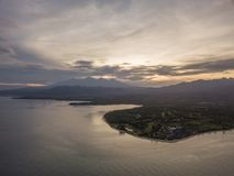 Aerial view of sunrise with Lombok in background royalty free stock photos