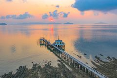Aerial view sunrise at pier of Phayam temple one landmark of Phayam island. Phayam temple is on Hin Kao gulf. .The temple is close to the shipping port. in the royalty free stock images