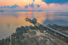 Aerial view sunrise at pier of Phayam temple one landmark of Phayam island. Phayam temple is on Hin Kao gulf. .The temple is close to the shipping port. in the royalty free stock photos