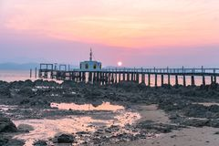 Aerial view sunrise at pier of Phayam temple one landmark of Phayam island. Phayam temple is on Hin Kao gulf. .The temple is close to the shipping port. in the stock photos