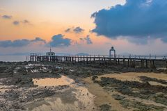 Aerial view sunrise at pier of Phayam temple one landmark of Phayam island. Phayam temple is on Hin Kao gulf. .The temple is close to the shipping port. in the stock image