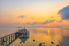 Aerial view sunrise at pier of Phayam temple one landmark of Phayam island. Phayam temple is on Hin Kao gulf. .The temple is close to the shipping port. in the stock photo