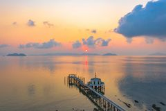 Aerial view sunrise at pier of Phayam temple one landmark of Phayam island. Phayam temple is on Hin Kao gulf. .The temple is close to the shipping port. in the royalty free stock photography