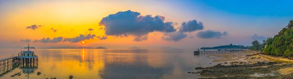 Aerial view sunrise at pier of Phayam temple one landmark of Phayam island. Phayam temple is on Hin Kao gulf. .The temple is close to the shipping port. in the stock images