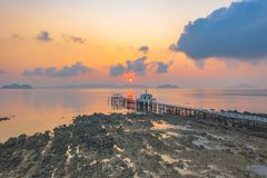Aerial view sunrise at pier of Phayam temple one landmark of Phayam island. Phayam temple is on Hin Kao gulf. .The temple is close to the shipping port. in the royalty free stock image