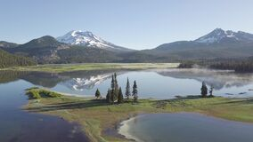 Aerial view of sunrise at Sparks Lake, Bend, Oregon, USA Drone panorama view of picturesque northwest natural landscape