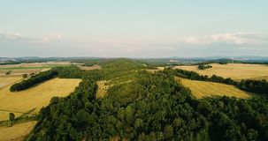 Aerial view sunrise, sunset over of Forest. Flying over Magical Forest in the mountains. Beautiful view of nature. Traveling background stock video footage
