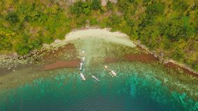 Aerial view Sunset and Atwayan beach with rocks. Travelling tour in Asia: Palawan, Philippines. Aerial view Sunset and Atwayan beach with rocks and boats stock footage