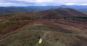 Aerial view Sunset on Max Patch MountainAppalachian Mountains, Tennessee & North Carolina, young woman in yellow dress. Aerial view Sunset on Max Patch stock video footage