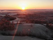 Aerial view of sunset over a landscape with forest royalty free stock photo