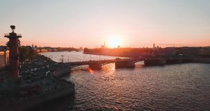 Aerial view of sunset over Neva river and Rostral columns in Saint Petersburg, Russia. Vasilievskiy island city from. Above, cinematic drone video, historical stock video footage