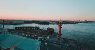Aerial view of sunset over Neva river and Rostral columns in Saint Petersburg, Russia. Vasilievskiy island city from. Above, cinematic drone video, historical stock video