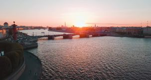 Aerial view of sunset over Neva river in Saint Petersburg, Russia. Vasilievskiy island city from above, cinematic drone. Video, historical buildings of nothern stock video footage