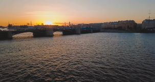 Aerial view of sunset over Neva river in Saint Petersburg, Russia. Vasilievskiy island city from above, cinematic drone. Video, historical buildings of nothern stock footage