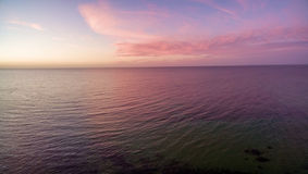 Aerial view of sunset over ocean. Nothing but sky, clouds and wa Royalty Free Stock Image