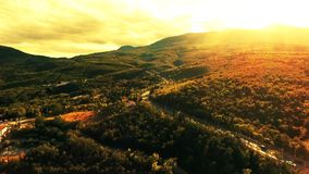 Aerial view on sunset and the road in the mountains to sea with cars, trucks and other tranportation stock footage