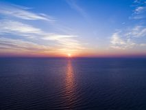 Aerial view of a Sunset sky background. Aerial Dramatic gold sunset sky with evening sky clouds over the sea. Stunning sky clouds. In the sunset. Sky landscape stock photos