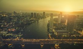 Aerial view of sunset sky over chaopraya river and sathorn bridg Royalty Free Stock Image