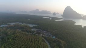 Aerial view of sunset at tropical bay. Aerial drone view of sunset at tropical Phang-nga bay in Thailand stock video footage