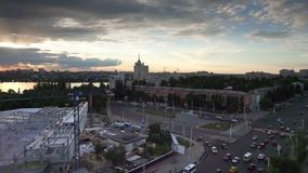 Aerial view, sunset in Voronezh, North Bridge, construction and cranes. Aerial view from roof top, City landscape, sunset in Voronezh, Russia, view of the North stock video