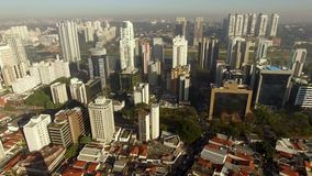 Aerial view of the super crowded, populated, and busy Sao Paulo city in the Brazil. Showcasing the sea of buildings that characterize its world wide known stock video footage