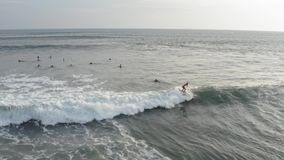 Aerial View of Surfer Riding Blue Ocean Wave. Drone 4k shot surfing ocean lifestyle, extreme sports. stock video footage