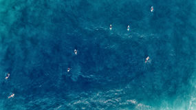 Aerial view of Surfer swimming on board near huge blue ocean wav. E Royalty Free Stock Photography
