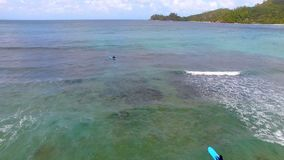 Aerial View Of Surfers, Baie Lazare Beach, Mahe Island, Seychelles 2 stock footage