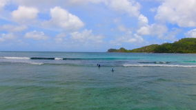 Aerial View Of Surfers, Baie Lazare Beach, Mahe Island, Seychelles 7 stock video