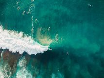 Aerial view of surfers and barrel wave in blue ocean. Surfer on wave. Top view Royalty Free Stock Photos