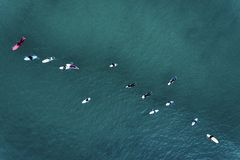 Aerial view of surfers in the ocean at the Baleal beach in Peniche royalty free stock image