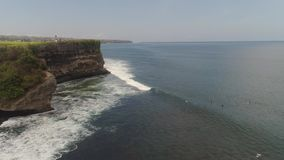 Surfers on the water surface. Aerial view surfers on water surface ocean catch wave. People learning to surf bali, indonesia stock video footage