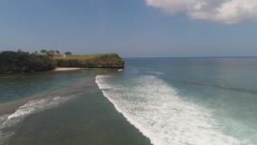Surfers on the water surface. Aerial view surfers on water surface ocean catch wave. People learning to surf bali, indonesia stock video