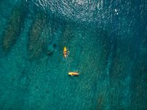 Aerial view of surfing. Surfing in ocean Royalty Free Stock Image
